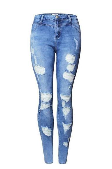 Medium-Washed High-Waisted Skinny Jeans Featuring Heavily Distressing Detailing